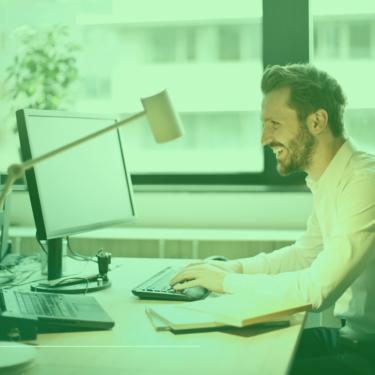 man happy computer